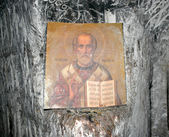 Orthodox icon of St. Nicholas in the cave church — Stock Photo