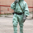 Man in chemical suit - Stock Photo