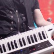 Man playing on a synthesizer - Stock Photo
