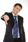 Podnikatel ukazuje palec dolů — Stock fotografie