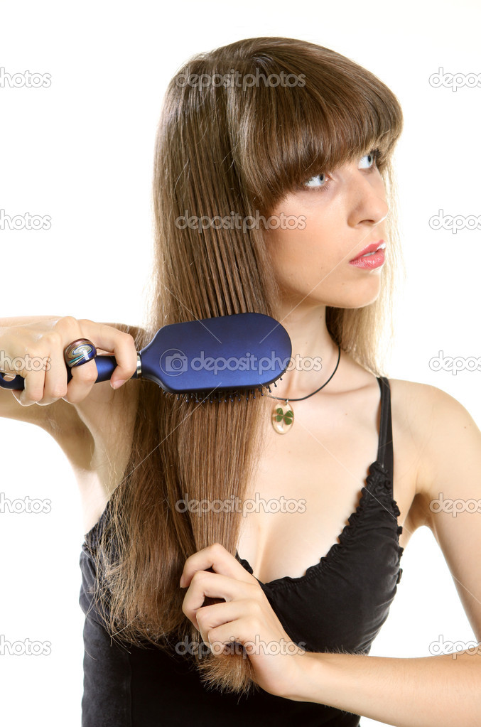 Smiling beautiful young woman combing her long brown hair with hairbrush - isolated — Stock Photo #6398205
