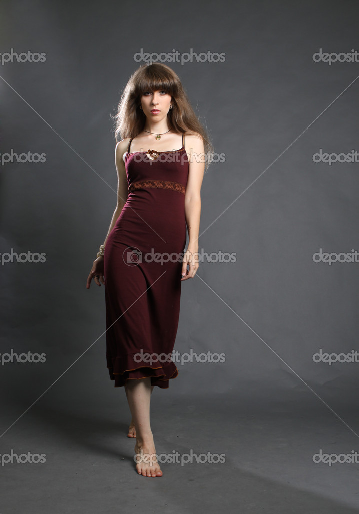 Studio fashion photo of beautiful young woman in elegance dress. — Stock Photo #6454399