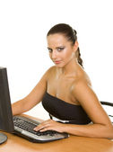 Pretty business woman at office desk — Stock Photo