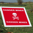 Stock Photo: Warning sign on mined area