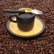 Coffeecup and spoon on beans — Stock Photo #5932881