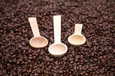 3 Coffee spoons on the beans — Stock Photo
