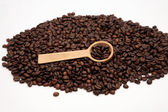 Coffee spoon on the beans — Stock Photo