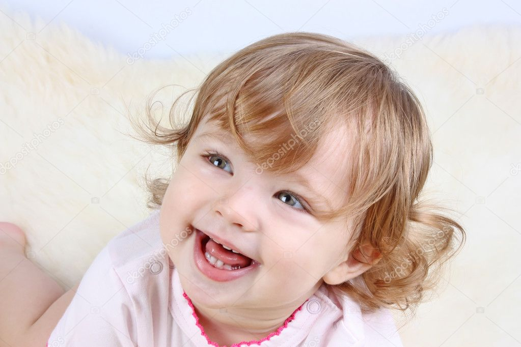 Smiling little girl with curly-headed hair in pink dress — Stock Photo #6286262