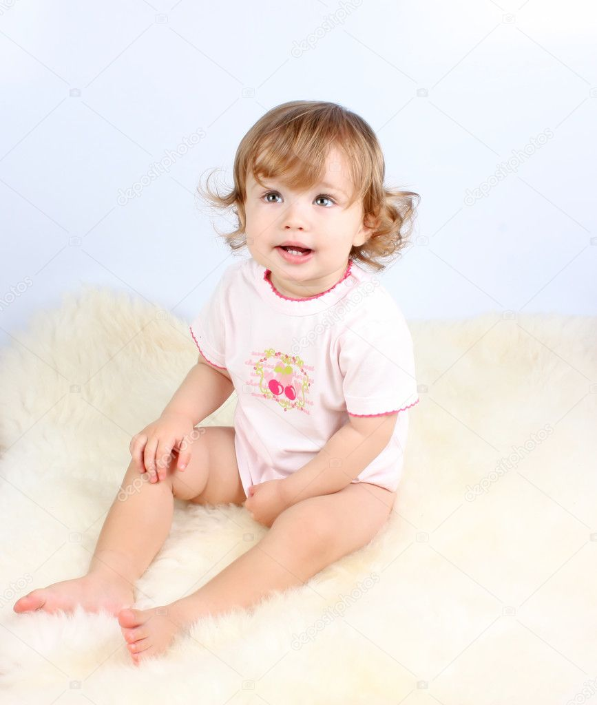 Smiling little girl with curly-headed hair in pink dress  Stock Photo #6286266