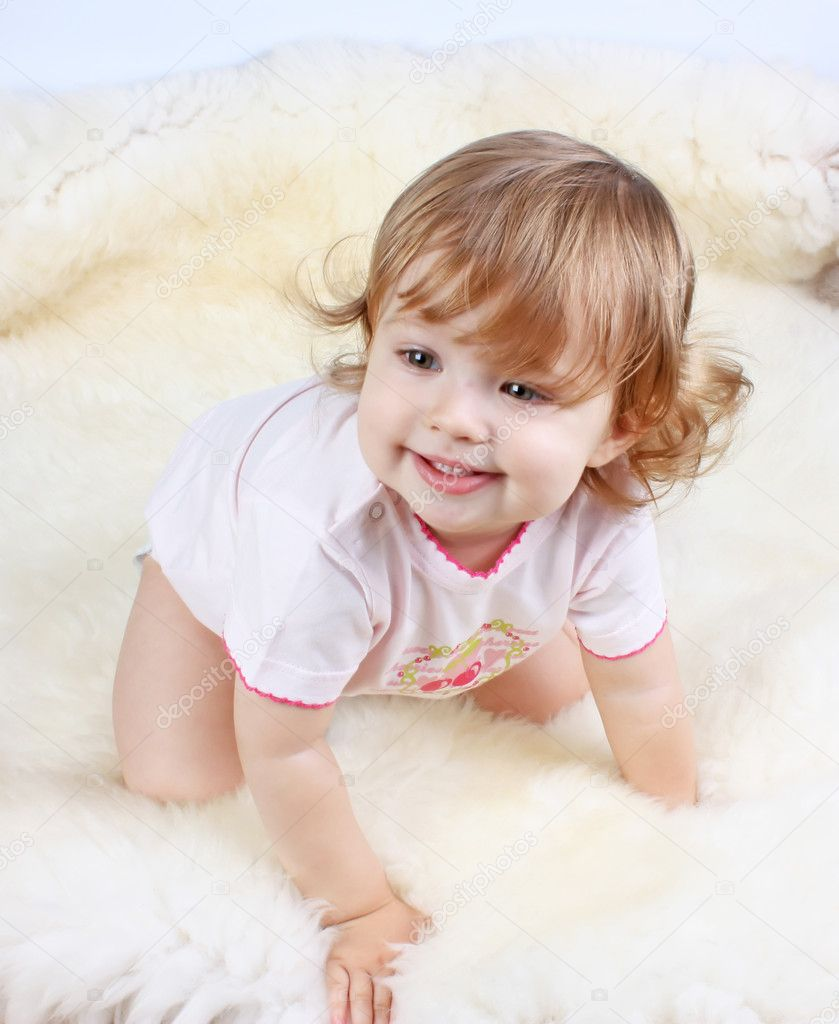 Smiling little girl with curly-headed hair in pink dress — Stock Photo #6286270