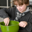 Boy making the dough for the cakes — Stock Photo