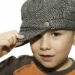 Boy holding his hat - Stock Photo