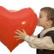 Little 5-year old holding a valentine heart. — Стоковая фотография