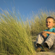 Boy In The Dunes Thinking — Stock Photo #5917898