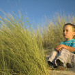 Boy Sitting In The Dunes — Stock Photo