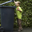 Stock Photo: Boy Trashing Can