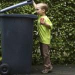 Boy Trashing A Can — Stock Photo