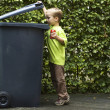 Stock Photo: Boy Trashing A Can