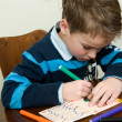 Foto Stock: Writing And Drawing Boy