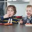 Boys tasting tomato — Stock Photo