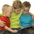 Stock Photo: Three Reading Boys