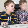 Boys on a computer — Stock Photo