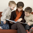 Mother And Two Sons Reading A Book 1 - Stock Photo