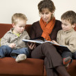Mother And Two Sons Reading A Book 3 — Stock Photo