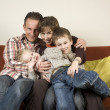 Family On A Couch 3 - Stock Photo