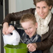 Mother and son mixing the dough — Stock Photo
