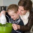Mother and son mixing the dough — Stock Photo #5918325