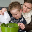 Mother and son mixing the dough — Stock Photo #5918328