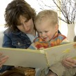 Stock Photo: Mother and son reading