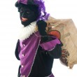Zwarte Piet with a bag full of presents — Stock Photo