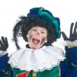 Child playing Zwarte Piet or Black Pete — Stock Photo