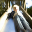 Boy down the slide - Stock Photo