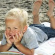 Stock Photo: Boy Lying On Beach