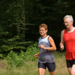 Senior couple running — Stock Photo