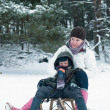 Boy and girl on a sled - Stock Photo
