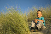 Boy In The Dunes Thinking — Stock Photo