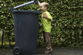 Boy Trashing A Can — Stock Photo