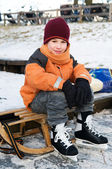 Little boy on a sled — Stock Photo