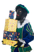 Zwarte Piet mit Geschenken — Stockfoto