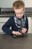 Boy cleaning the kitchen — Stock Photo