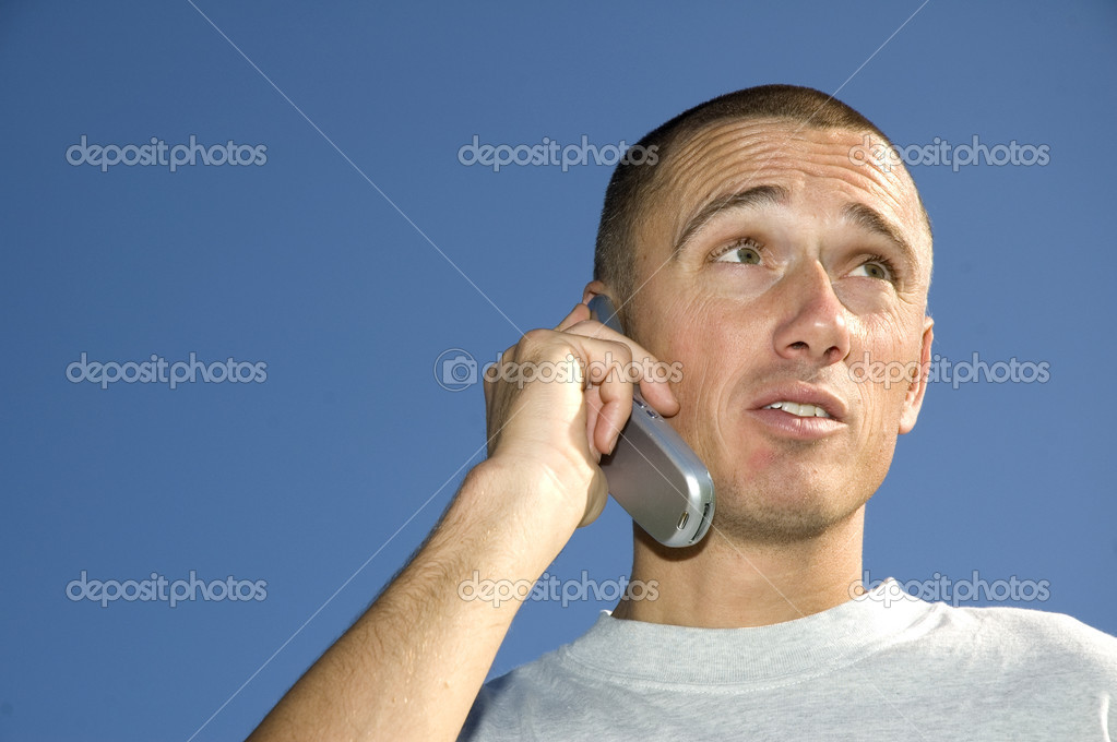Boy on the phone looking surprised — Stock Photo #5918581