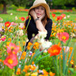 Stock Photo: Pretty Womin Field of Flowers