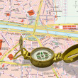 Stock Photo: Gold compass isolated over map