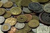 Coins of several countries — Stock Photo