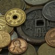 Coins of several countries - Stock Photo