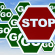 Road sign with stop and go — Stock Photo